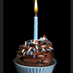 A cupcake with a single candle marks the GCA first birthday.